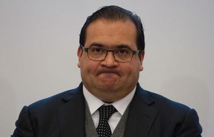Hallan 23 mdp en cajas de carton rastreando a Javier Duarte