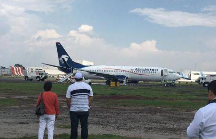 Explosión en avión suspende operaciones del AICM