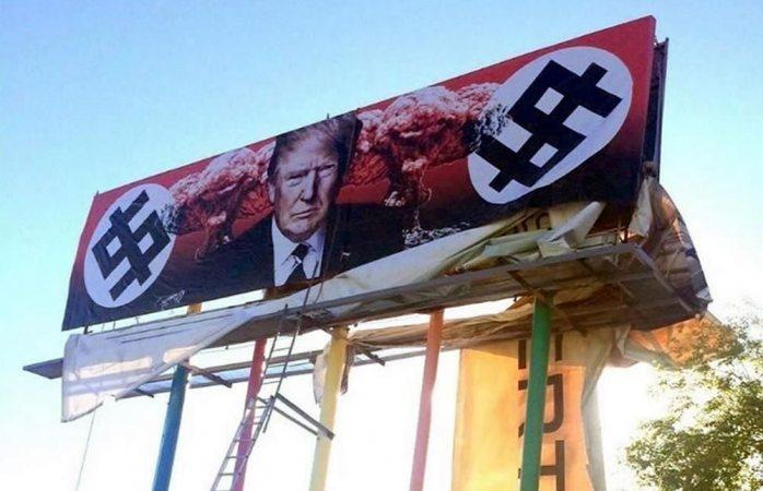 Protestan contra muro con Trump nazi en espectacular