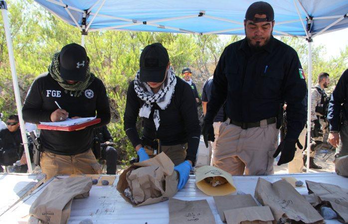 Recuperan cerca de 200 huesos humanos de fosa clandestina