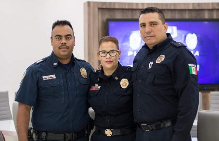 Dos hombres y una mujer, policías que rescataron a joven de electrocutarse