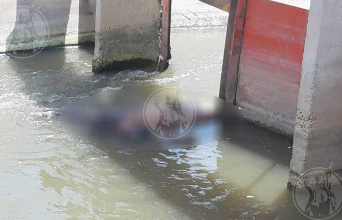Hallan muerto en canal de Juárez