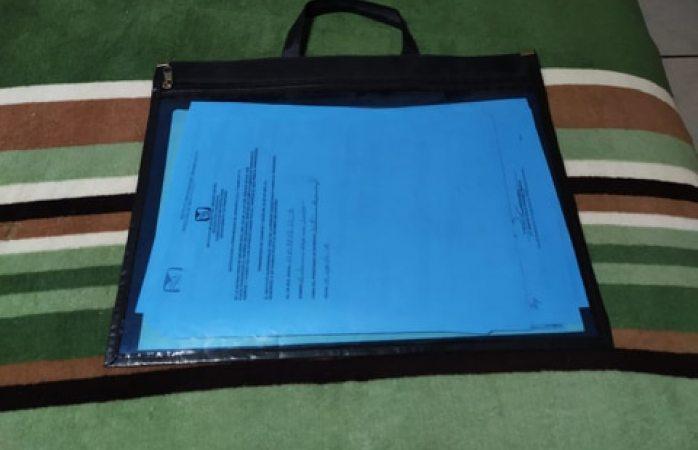 Buscan bolsa con papeles oficiales